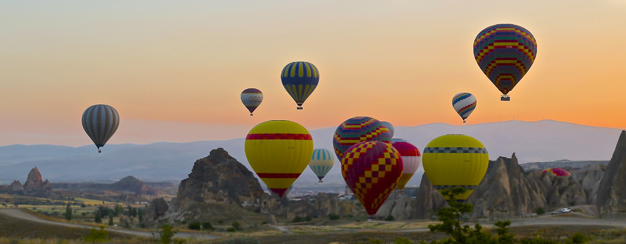 Hot air balloons flying in the sunset